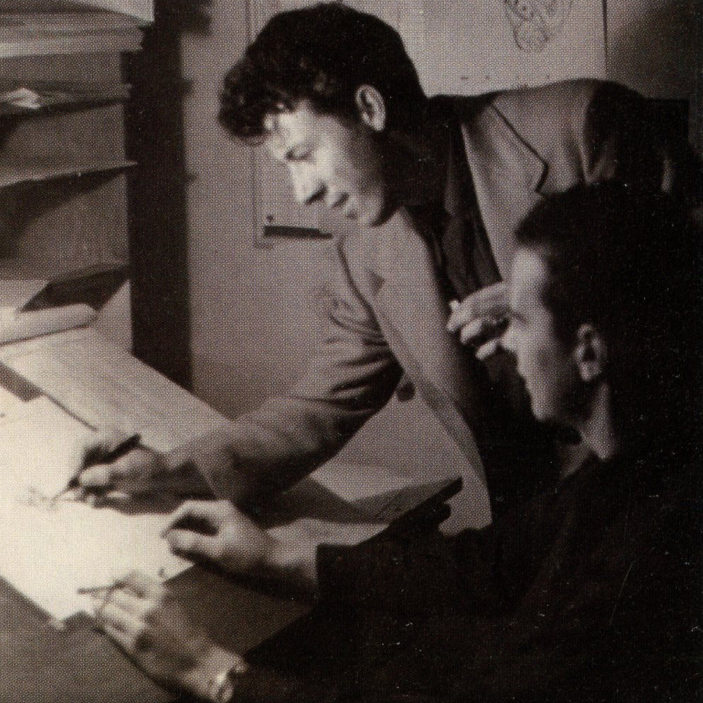Fred Moore going over Ollie Johnston's drawing.